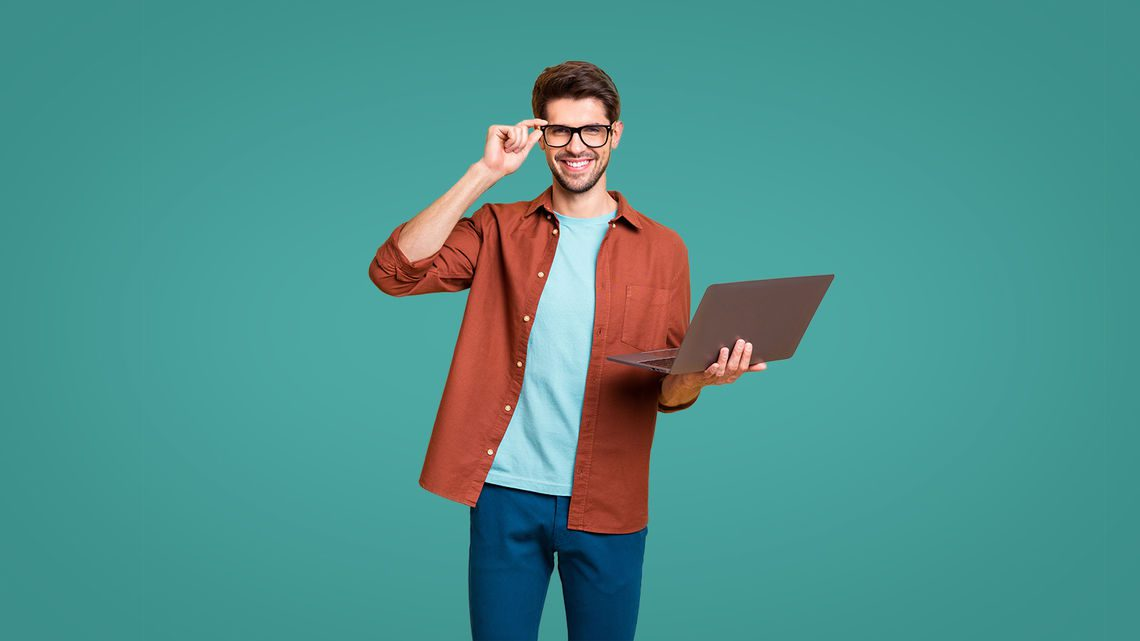 man with laptop on green background