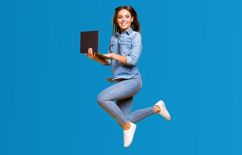 woman with laptop leaping